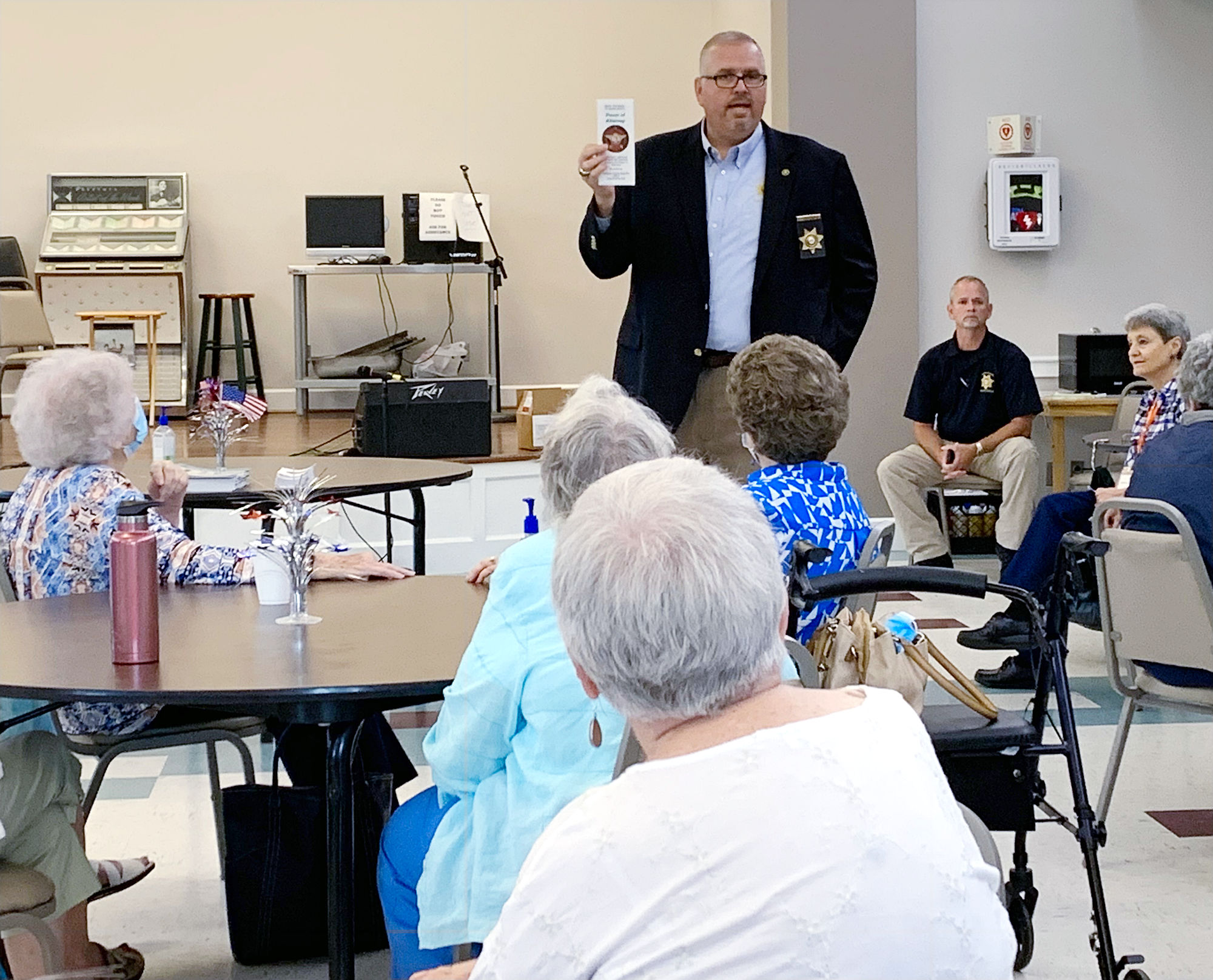 Sheriff Gary Sisk talks with people at the Catoosa County Senior Center.